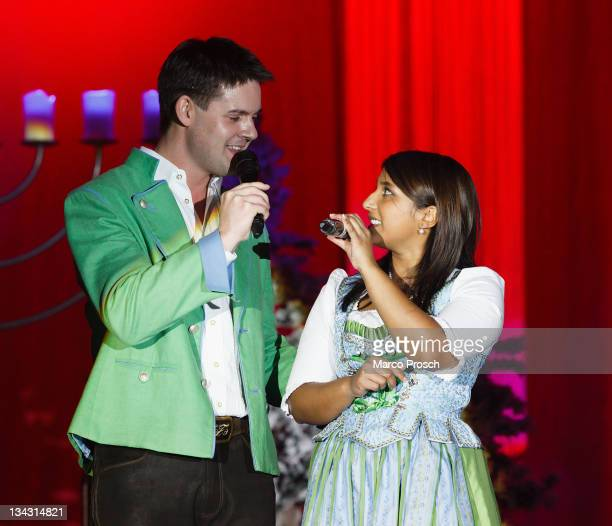 Florian Fesl and Belsy Demetz perform on stage during the 'Alpenlaendische Weihnacht' Show at the Goebel's Hotel Arena on November 30, 2011 in...