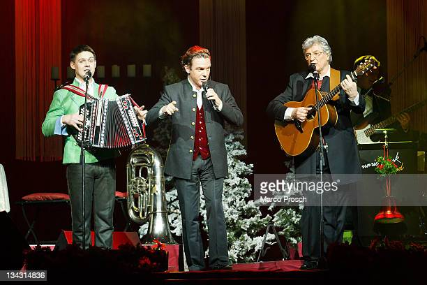 Florian Fesl Stefan Mross and Michael Hartl perform on stage during the 'Alpenlaendische Weihnacht' Show at the Goebel's Hotel Arena on November 30...