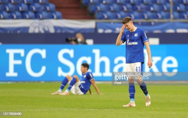 Florian Flick of FC Schalke 04 looks dejected after the Bundesliga match between FC Schalke 04 and Hertha BSC at Veltins-Arena on May 12, 2021 in...