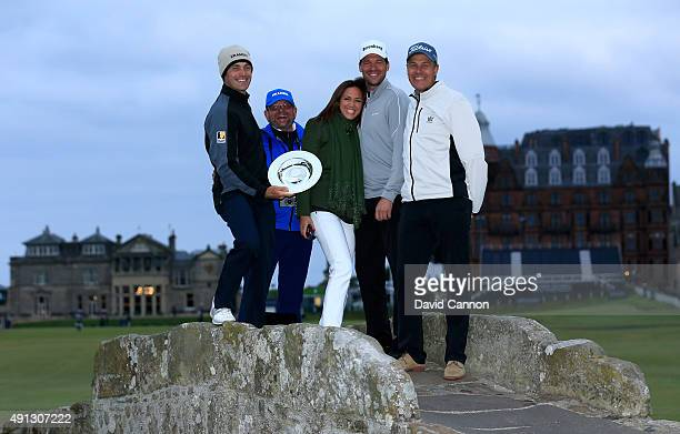 Florian Fritsch of Germany and German footballer Michael Ballack pose with their trophy on the Swilcan Bridge with their respective caddies and...