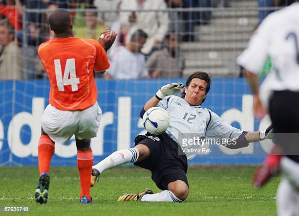 Florian Fromlowitz of Germany stops the shot from Collins John of Netherlands with his hand outside the sixteenth and receives later from referee...