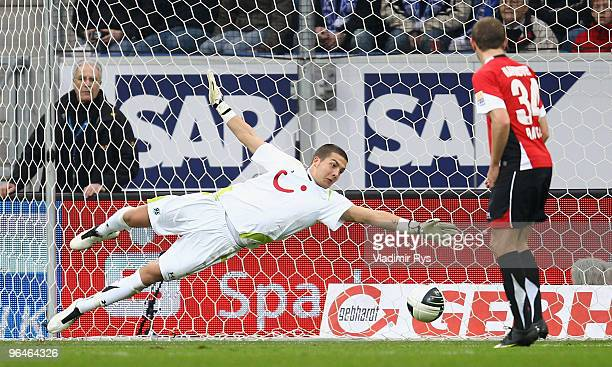 Florian Fromlowitz of Hannover concedes the first goal scored by Carlos Eduardo of Hoffenheim during the Bundesliga match between 1899 Hoffenheim and...