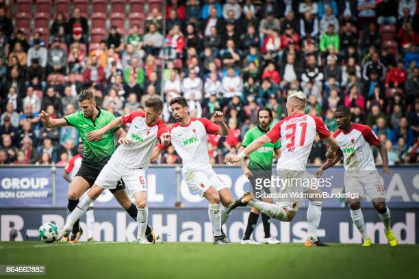 Florian Fuellkrug of Hannover 96 and Jeffrey Gouweleeuw of Augsburg compete for the ball during the Bundesliga match between FC Augsburg and Hannover...