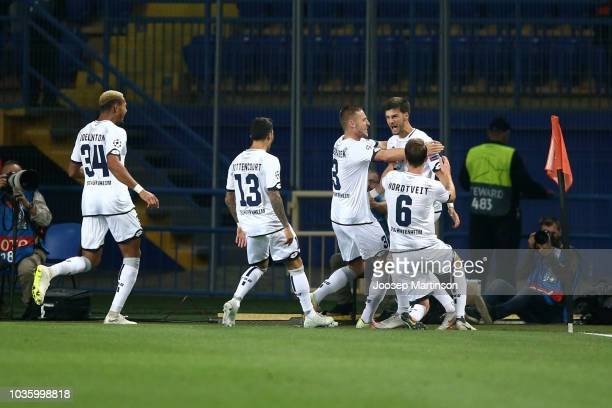 Florian Grillitsch of 1899 Hoffenheim celebrates after scoring his team's first goal with his team mates during the Group F match of the UEFA...