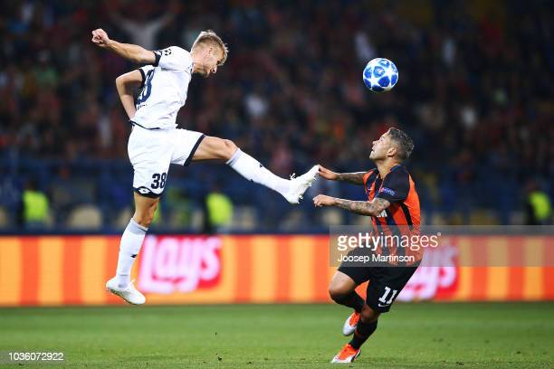 Florian Grillitsch of 1899 Hoffenheim competes with Marlos of Shakhtar Donetsk during the Group F match of the UEFA Champions League between FC...
