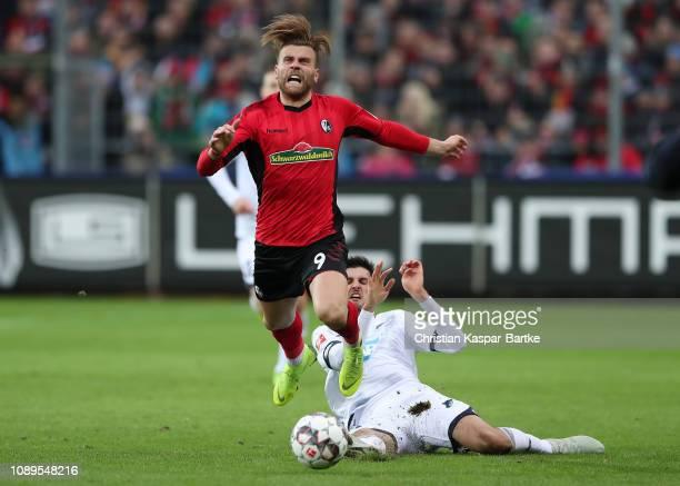 Florian Grillitsch of 1899 Hoffenheim fouls Lucas Holer of Freiburg during the Bundesliga match between Sport-Club Freiburg and TSG 1899 Hoffenheim...
