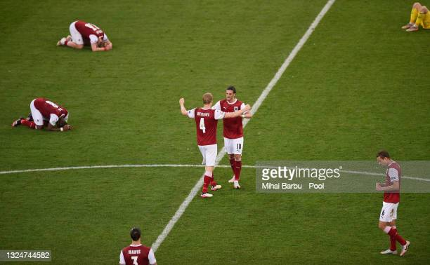 Florian Grillitsch of Austria celebrates their side's victory with team mate Martin Hinteregger after the UEFA Euro 2020 Championship Group C match...