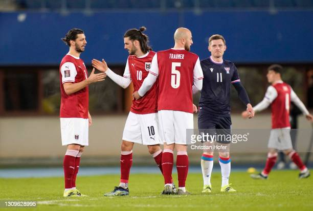 Florian Grillitsch of Austria celebrates victory with team mate Gernot Trauner following the FIFA World Cup 2022 Qatar qualifying match between...