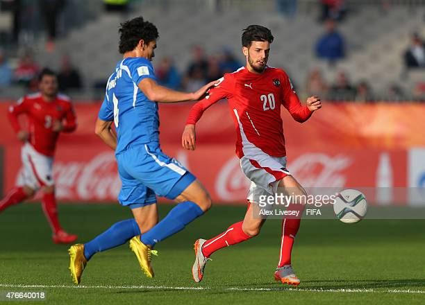 Florian Grillitsch of Austria runs at Rustamjon Ashurmatov of Uzbekistan during the FIFA U20 World Cup round of 16 match between Austria and...
