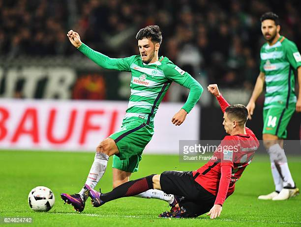 Florian Grillitsch of Bremen is challenged by Mijat Gacinovic of Frankfurt during the Bundesliga match between Werder Bremen and Eintracht Frankfurt...