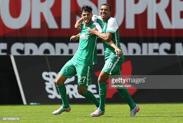 Florian Grillitsch of Bremen jubilates with team mate Leon Guwara after scoring the second goal during the third league match between FC Hansa...
