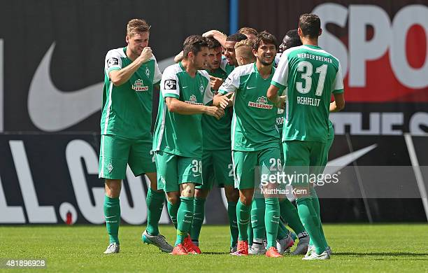 Florian Grillitsch of Bremen jubilates with team mates after scoring the second goal during the third league match between FC Hansa Rostock and SV...