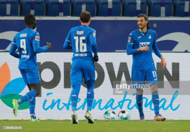 Florian Grillitsch of Hoffenheim celebrates his team's first goal with teammates Sebastian Rudy and Ihlas Bebou during the Bundesliga match between...