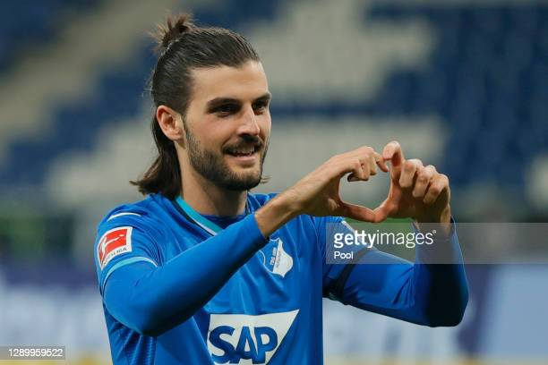 Florian Grillitsch of Hoffenheim celebrates his team's second goal during the Bundesliga match between TSG Hoffenheim and FC Augsburg at...