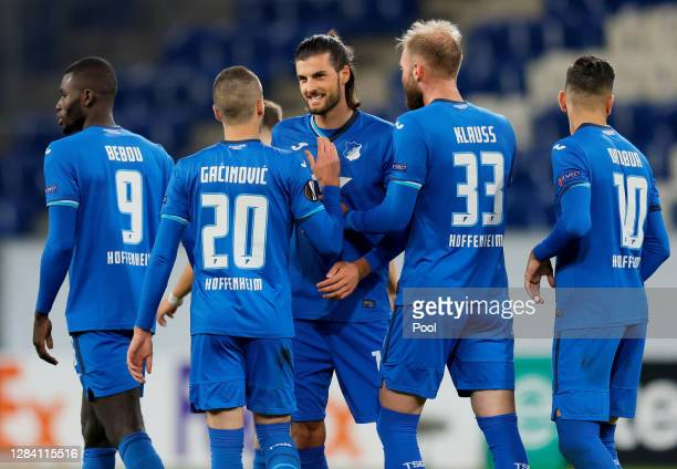 Florian Grillitsch of Hoffenheim celebrates with teammates after scoring his team's third goal during the UEFA Europa League Group L stage match...