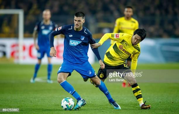 Florian Grillitsch of Hoffenheim is challenged by Shinji Kagawa of Dortmund during the Bundesliga match between Borussia Dortmund and TSG 1899...