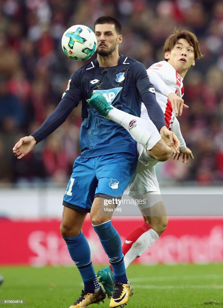 Florian Grillitsch (L) of Hoffenheim is challenged by Yuya Osako of Koeln during the Bundesliga match between 1. FC Koeln and TSG 1899 Hoffenheim at RheinEnergieStadion on November 5, 2017 in Cologne, Germany.