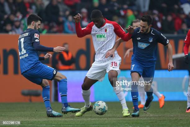 Florian Grillitsch of Hoffenheim Kevin Danso of Augsburg and Lukas Rupp of Hoffenheim battle for the ball during the Bundesliga match between FC...