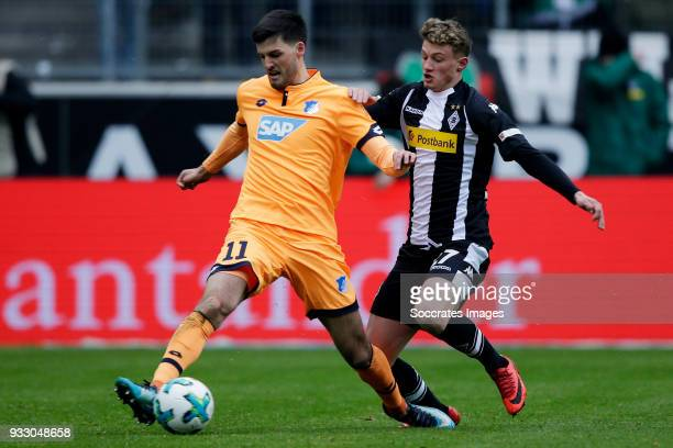 Florian Grillitsch of Hoffenheim Mickael Cuisance of Borussia Monchengladbach during the German Bundesliga match between Borussia Monchengladbach v...