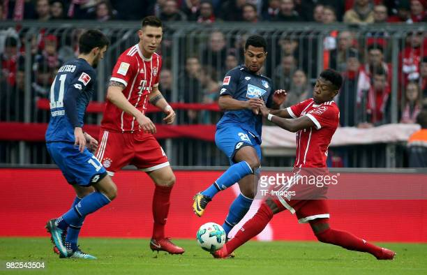 Florian Grillitsch of Hoffenheim Niklas Suele of Muenchen Serge Gnabry of Hoffenheim and David Alaba of Muenchen battle for the ball during the...