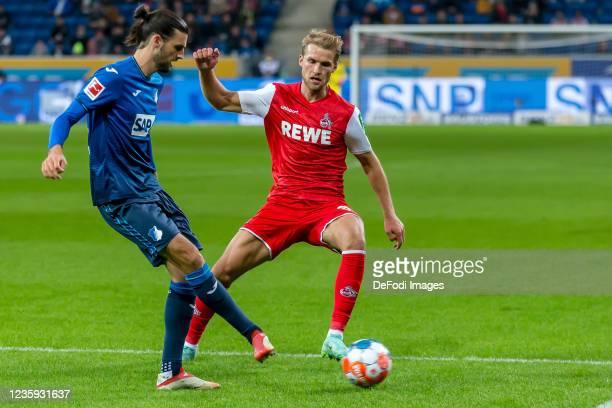 Florian Grillitsch of TSG 1899 Hoffenheim and Sebastian Andersson of 1.FC Koeln battle for the ball during the Bundesliga match between TSG...