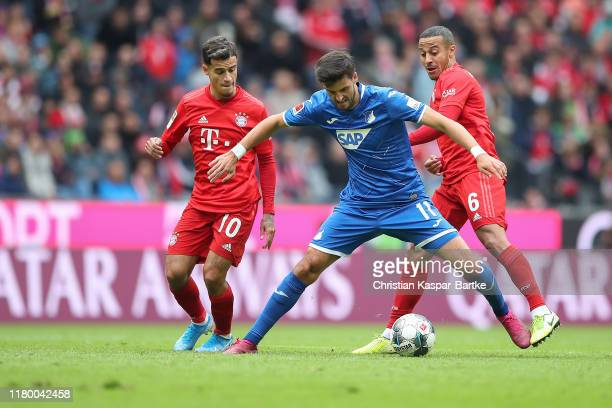 Florian Grillitsch of TSG 1899 Hoffenheim challenges Thiago of FC Bayern Muenchen and Philippe Coutinho of FC Bayern Muenchen during the Bundesliga...