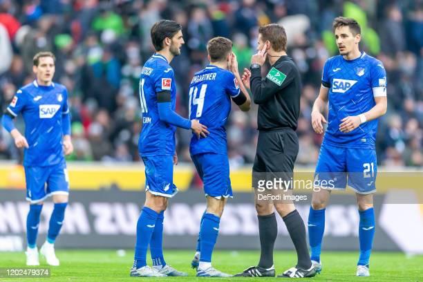 Florian Grillitsch of TSG Hoffenheim Christoph Baumgartner of TSG Hoffenheim referee Dr Felix Brych and goalkeeper Tobias Sippel of Borussia...