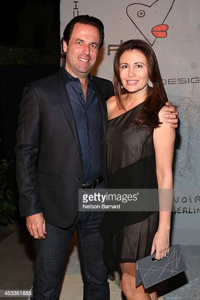 Florian Haffa and Jeanine Haffa attend the Porsche Design x Thierry Noir Art Basel Miami Beach Event at The Temple House on December 3 2013 in Miami...