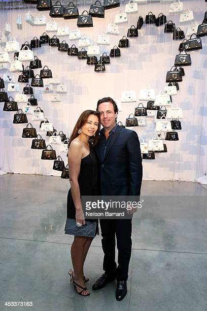 Florian Haffa and Jeanine Haffa attends the Porsche Design x Thierry Noir Art Basel Miami Beach Event at The Temple House on December 3 2013 in Miami...