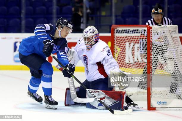 Florian Hardy goaltender of France makes a save on Kaapo Kakko of Finland during the 2019 IIHF Ice Hockey World Championship Slovakia group A game...