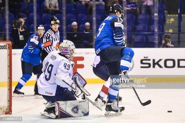 Florian Hardy of France saves shot by Veli-Matti Savinainen of Finland during the 2019 IIHF Ice Hockey World Championship Slovakia group A game...