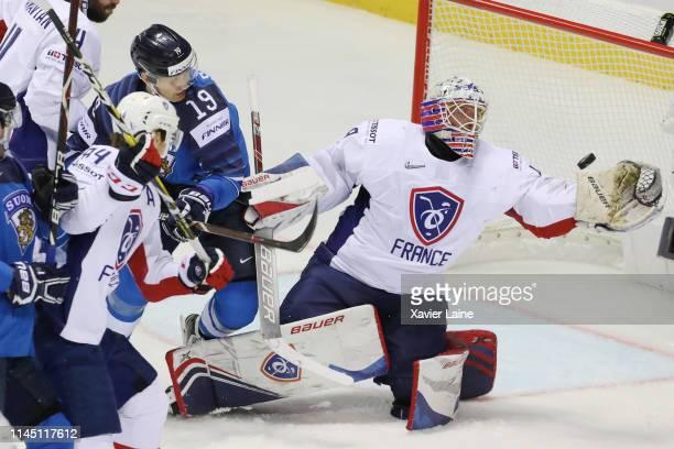 Florian Hardy of France stops the puck against Veli-Matti Savinainen of Finland during the 2019 IIHF Ice Hockey World Championship Slovakia group A...