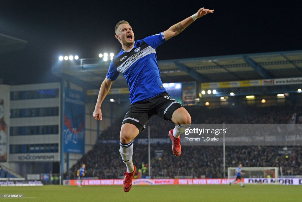Florian Hartherz of Bielefeld celebrates scoring his teams first goal during the Second Bundesliga match between DSC Arminia Bielefeld and SG Dynamo Dresden at Schueco Arena on February 23, 2018 in Bielefeld, Germany.