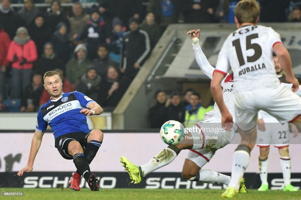 Florian Hartherz (L) of Bielefeld scores during the Second Bundesliga match between DSC Arminia Bielefeld and FC St. Pauli at Schueco Arena on December 1, 2017 in Bielefeld, Germany.