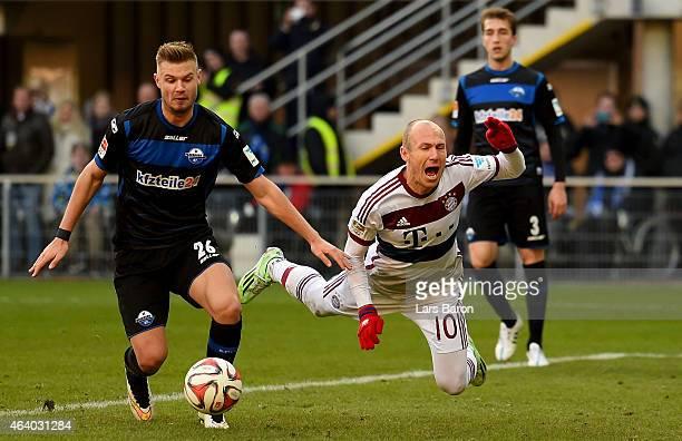 Florian Hartherz of SC Paderborn tackles Arjen Robben of Bayern Muenchen during the Bundesliga match between SC Paderborn and FC Bayern Muenchen at...