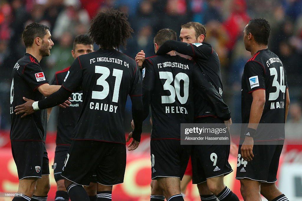 Florian Heller (C) of Ingolstadt celebrates scoring the 2nd team goal with his team mates during the Second Bundesligamatch between Jahn Regensburg and FC Ingolstadt at Jahnstadion on April 19, 2013 in Regensburg, Germany.