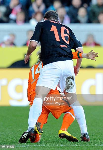Florian Heller of Mainz attacks Aaron Hunt and received after this situation the red card during the Bundesliga match between FSV Mainz 05 and SV...