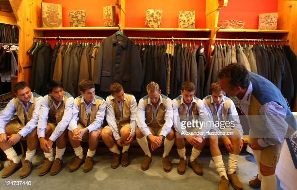 Florian Hinterberger sporting director of 1860 Muenchen smiles with his team after fitting traditional Bavarian Lederhose costumes at the LodenFrey...