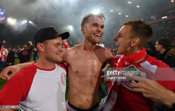 Florian Hubner of Union Berlin celebrates promotion with fans after the Bundesliga playoff second leg match between 1 FC Union Berlin and VfB...