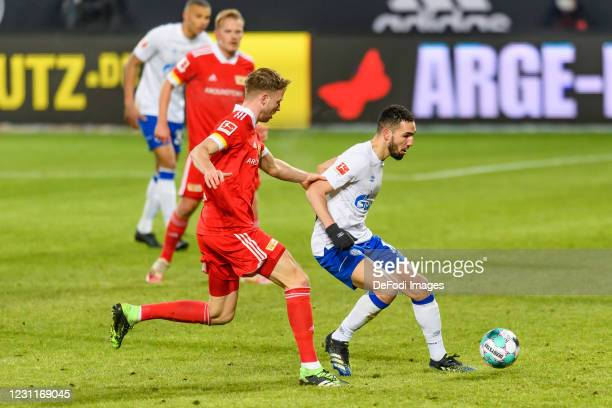 Florian Huebner of 1.FC Union Berlin and Nabil Bentaleb of FC Schalke 04 battle for the ball during the Bundesliga match between 1. FC Union Berlin...