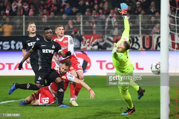 Florian Huebner of Berlin scores his team's second goal past goalkeeper Timo Horn of Koeln during the Second Bundesliga match between 1 FC Union...