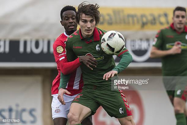Florian Jozefzoon of PSV Caglar Soyuncu of SC Freiburgduring the friendly match between PSV Eindhoven and SC Freiburg at the stadium Nuevo Mirador on...