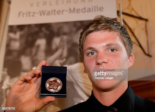 Florian Jungwirth of 1860 Munich poses with the silver Medal for the second best U19 player 2007/2008 during the Fritz Walter Medal Award 2008 at the...