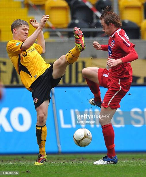 Florian Jungwirth of Dresden and Marc Schnatterer of Heidenheim fight for the ball during the Third League match between Dynamo Dresden and 1 FC...