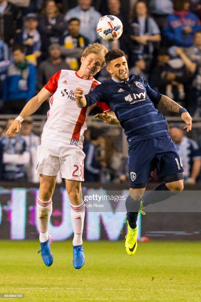Florian Jungwirth #23 of San Jose Earthquakes and Dom Dwyer #14 of Sporting Kansas City fight for a loose ball in the second half at Children's Mercy Park on March 18, 2017 in Kansas City, Kansas.