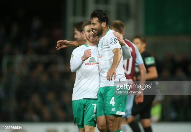 Florian Kainz and Claudio Pizarro of Bremen celebrate their teams first goal during the DFB Cup match between SC Weiche Flensburg 08 v SV Werder...