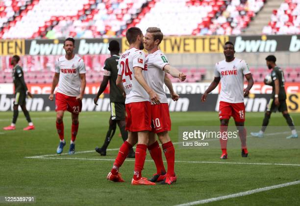 Florian Kainz of 1 FC Koeln celebrates with his teammate Dominick Drexler of 1 FC Koeln after scoring his team's second goal during the Bundesliga...