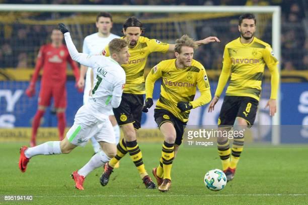 Florian Kainz of Bremen and Andre Schuerrle of Dortmund battle for the ball during the Bundesliga match between Borussia Dortmund and SV Werder...