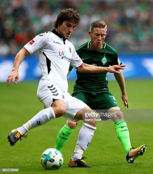 Florian Kainz of Bremen and Caglar Soeyuencue of Freiburg battle for the ball during the Bundesliga match between SV Werder Bremen and SportClub...