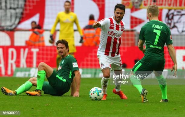 Florian Kainz of Bremen and Leonardo Bittencourt of Koeln battle for the ball during the Bundesliga match between 1 FC Koeln and SV Werder Bremen...